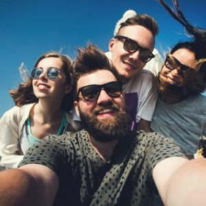 stock-photo-multiracial-group-of-young-hipster-friends-make-selfie-photo-with-smartphone-camera-in-phuket-while-260752652